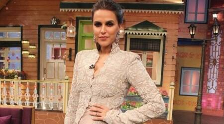 Neha Dhupia meets with an accident, crowd tries to take selfies