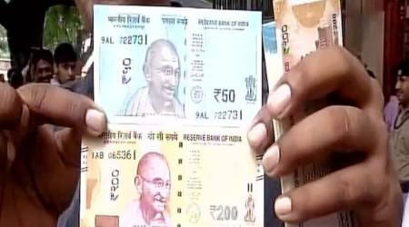 People queue outside RBI to withdraw new notes in denominations of Rs 50, Rs200