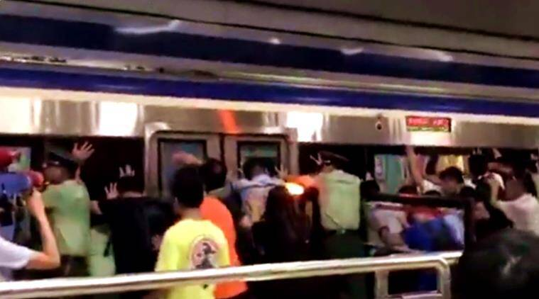 passengers push train, china train pushed, passengers save man's life, china station, train station china, indian express, indian express news