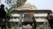 Sensex gets a scare on global headwinds, dives 287points