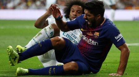 Barcelona's Luis Suarez out for four weeks