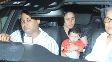 Taimur is happily sitting like a boss in mother Kareena Kapoor Khan's lap. See photos