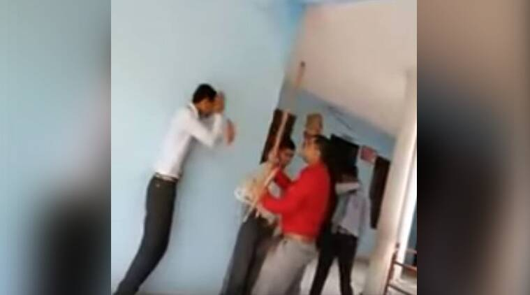 principal beating students, students thrashed, Allahabad teacher hits children, Child abuse, India news, Indian Express