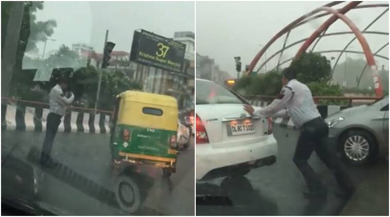 delhi traffic policeman, delhi traffic policeman in rains, traffic policeman respect working in rains, delhi traffic policeman video of qorking in rains viral, delhi traffic policeman video viral, delhi traffic policeman controlling traffic viral, indian express, indian express news