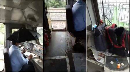 Train driver holds umbrella to save control panel from leaky roof, video goes viral