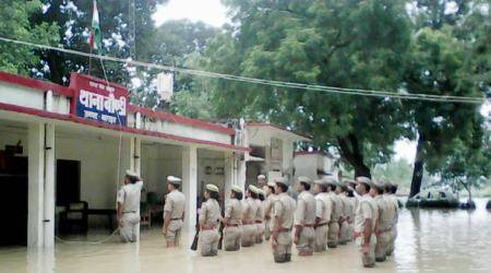 Photos of police personnel in flooded UP celebrating Independence Day are going viral