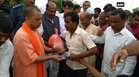 UP floods: CM Yogi Adityanath visits flood-affected Gorakhpur, distributes food material to locals