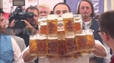 VIDEO: Man creates record by carrying 29 BEER MUGS and not dropping a SINGLEone!