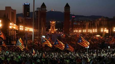 Catalans occupy voting stations to defy Spain's order to stopreferendum