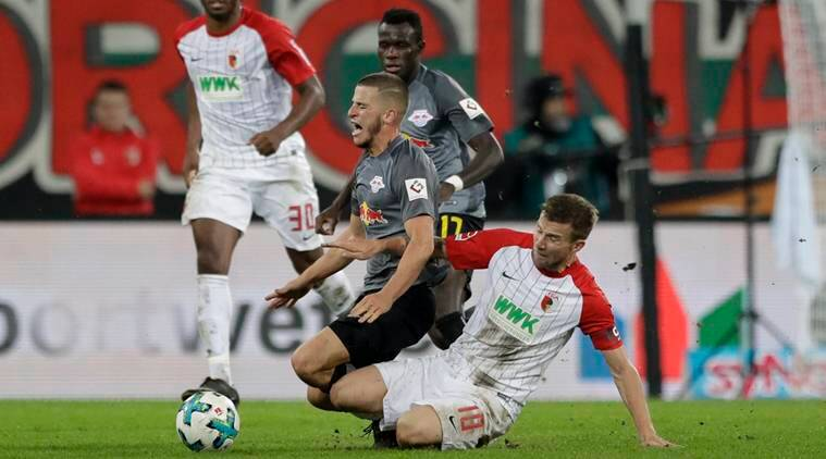 Augsburg captain Baier fined, banned for obscene gesture