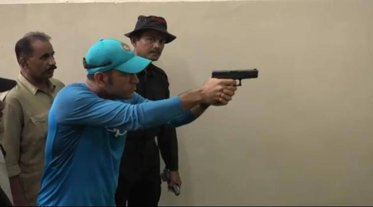 Image result for dhoni shooting