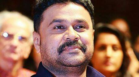 Superstar Dileep collects passport from court for travel to Dubai