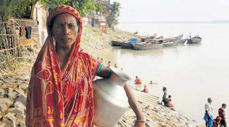 Down the Ganga: In this village, toilets do have water, but they come at a price
