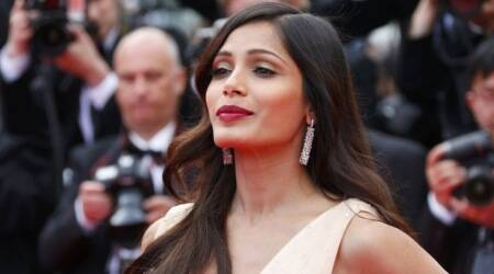 Freida Pinto makes a powerful statement in Louis Vuitton on the cover of this magazine