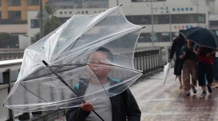 japan, typhoon japan, japan weather, flights cancelled japan typhoon, japanese storm, world news, indian express