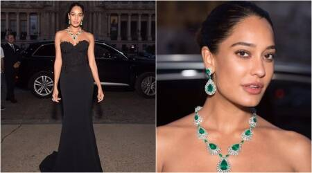 Lisa Haydon embodies Parisian elegance in this stunning black off-shoulder gown