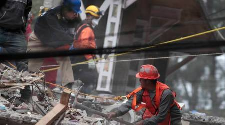 Hopes dimming under rubble, Mexico woman's texts help save her