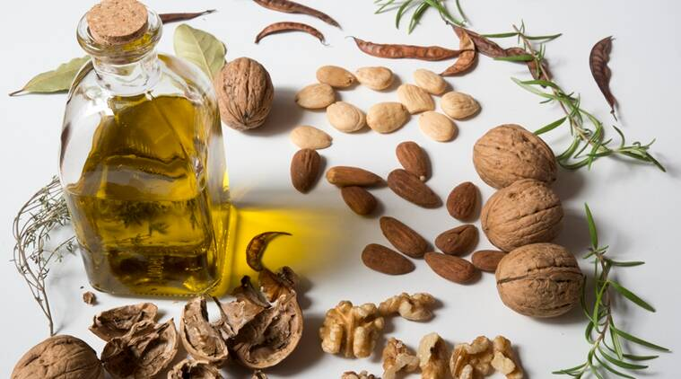 benefits of eating nuts, benefits of olive oil, eating nuts to improve intelligence, connection between eating nuts and intelligence, Indian express, Indian express news