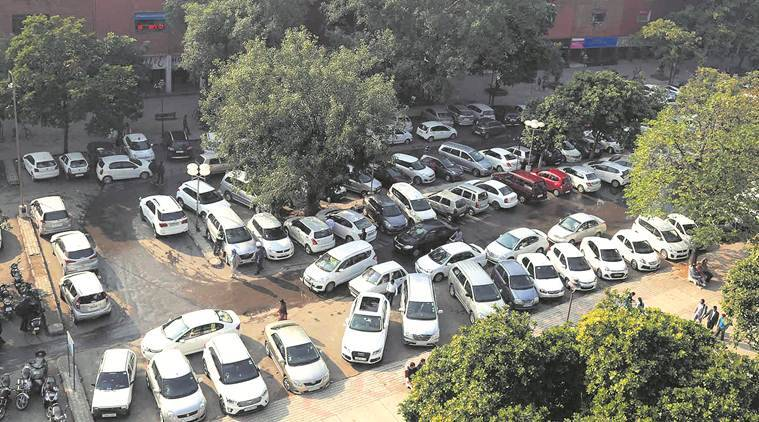 government officers news, paid parking news, india news, indian express news