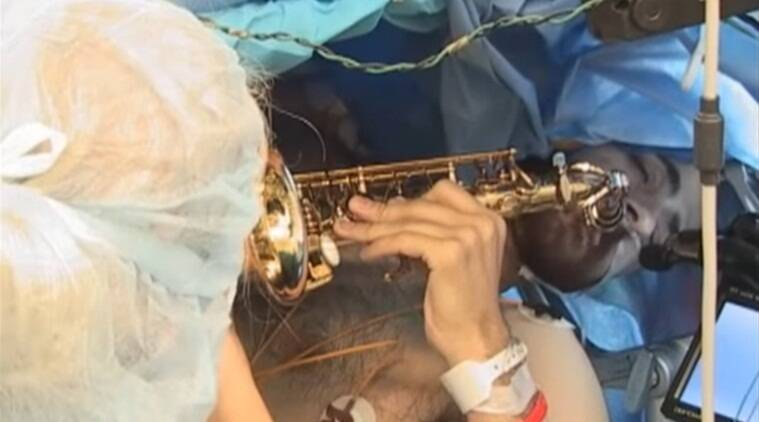 patient playing during surgery, musical instrument, Saxophone, playing Saxophone during surgery, music professor, Indian express, Indian express news