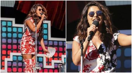 Priyanka Chopra pulls off the sassy '60s in this floral Fausto Puglisi dress at the Global Citizen Festival