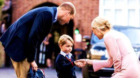 Britain's Prince William accompanies Prince George as he is met by Helen Haslem - the head of the lower school on arrival for his first day of school at Thomas's school in Battersea, London. (File/AP)