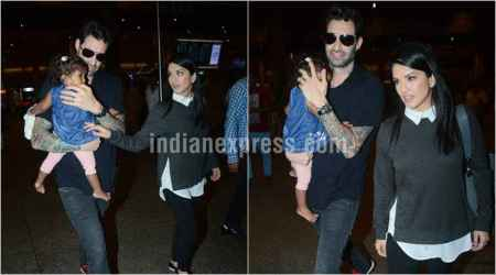 Sunny Leone keeps an eye on daughter Nisha as she walks out of the airport with husband Daniel Weber