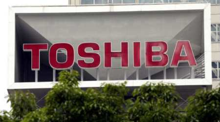 Toshiba agree on chip business sale to Bain-led consortium protested