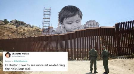 After Donald Trump signed DACA orders, a 65-ft child peers at the US-Mexico wall