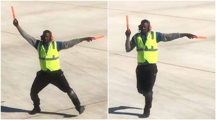 man dance while giving signals to pilot, aircraft marshalling, dancing ground personnel, aircraft signal dance, aircraft signalling, indian express, indian express news