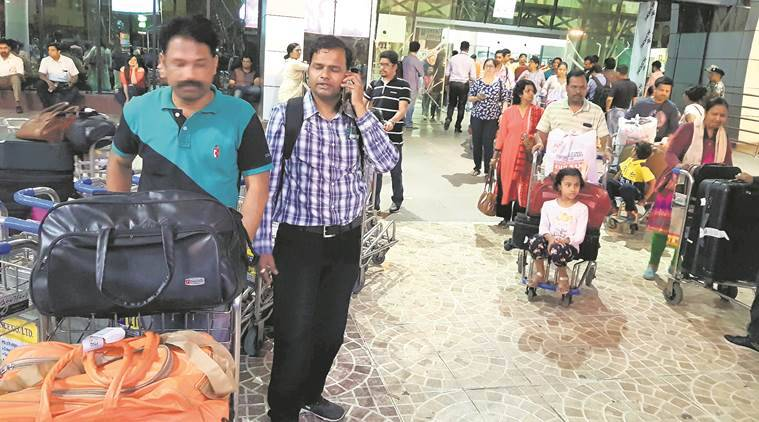 Pune airport , Pune airport  facilities,  Airport Authority of India , lack of chairs and trolleys at pune airport, pune airport problems, pune news, indian express news