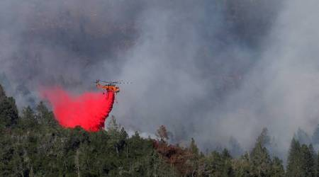 Crews push to contain California fires, search forbodies