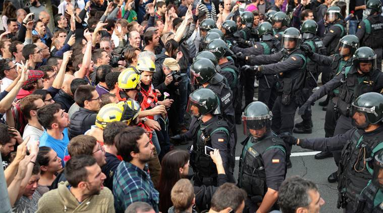 Spanish police storm polling station in Catalonia