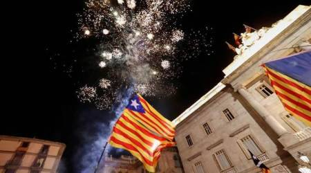Catalonia, Spain, Carles Puigdemont, Mariano Rajoy, catalonia photos, spain protest photos, catalonia independence pictures, independence referendum, catalonia independence celebration pics, catalonia violent protest pictures, catalan independence images, spanish flags, catalan flags, images, european union, euro news, indian express