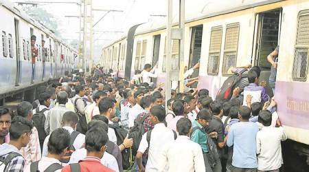 To beat overcrowded trains, commuters trek along tracks, board near car shed