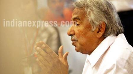 Oommen Chandy poses 'SBI save challenge'