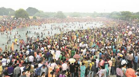 Chandigarh: Chhath Puja devotees throng Sector 42 lake to offer prayers and fruits to Sun God