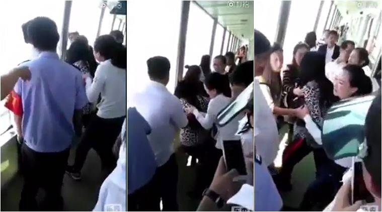 china, bizarre video, weird video, funny videos, chinese woman phone fall video, mobile fall in lake video, people losing phone video, viral video, indian express