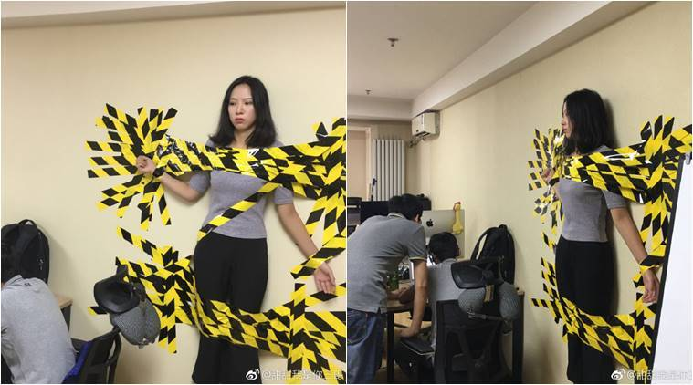 believe it or not this chinese woman was taped to her office wall