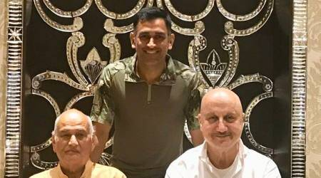 MS Dhoni poses with real life and reel life father Anupam Kher