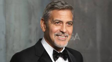 George Clooney limps on the airport runway after scooter crash