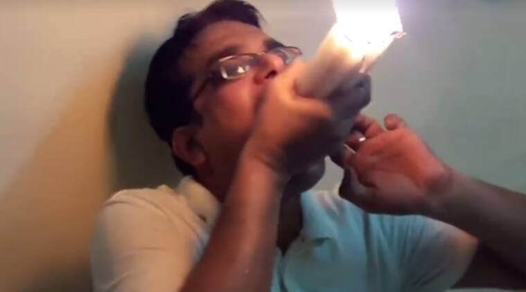 Guinness world record, guinness world record holder, man stuffs in 22 lit candles in mouth, man creates record for putting candles in mouth, outrageous facts, indian express, indian express news