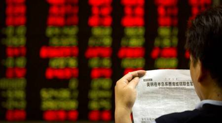 China stocks fall as GDP growth cools, property sales drop; Hong Kong flat