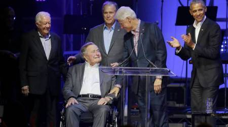 Former US Presidents take stage at hurricane benefit concert