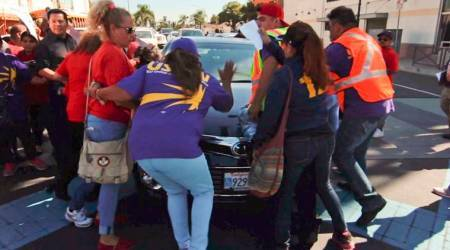Man drives car into immigration rally in California, arrested
