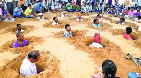 Outside Jaipur, farmers neck-deep in protest against land acquisition