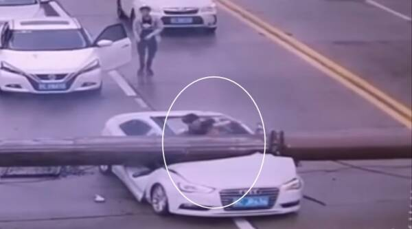 bizarre videos, man saved after accident videos, accident videos, man survives after crane falls on car, strange accident videos, indian express, indian express news