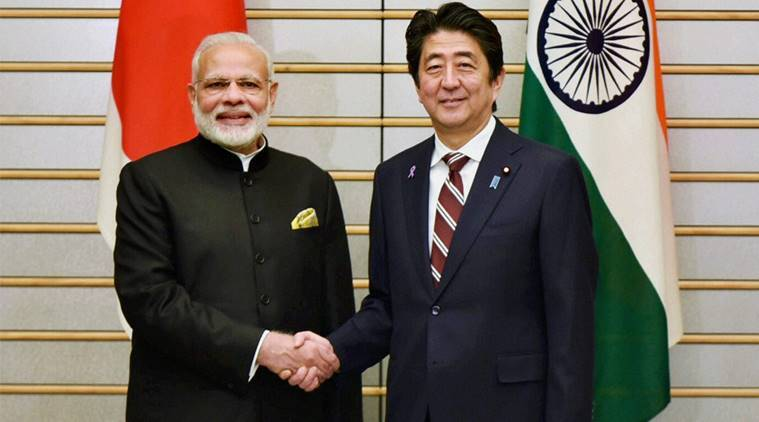 Prime Minister Narendra Modi shakes hands with his Japanese counterpart Shinzo Abe in Tokyo, Japan in 2016. (Source: PTI Photo, file)