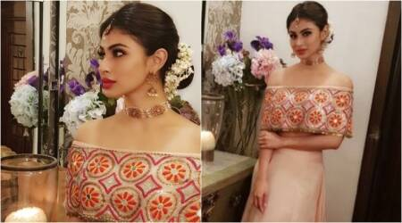 Mouni Roy's off-shoulder blouse adds a sensual modern twist to a traditional lehenga