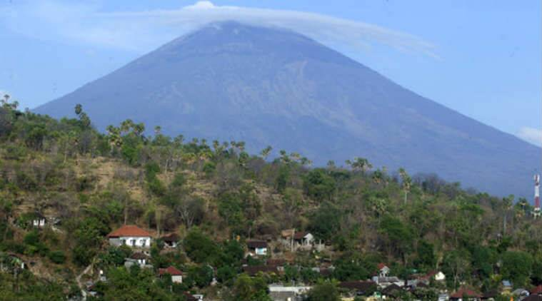 Volcano, Bali volcano, Mount Agung Bali, Mount Agung alert lowered, Indonesian authorities, imminent volcanic eruption, displaced people, Kuta, volcanic tremors, rising magma, volcano danger zone, Agung's crater, Ring of Fire, Mount Sinabaug, Sumatra